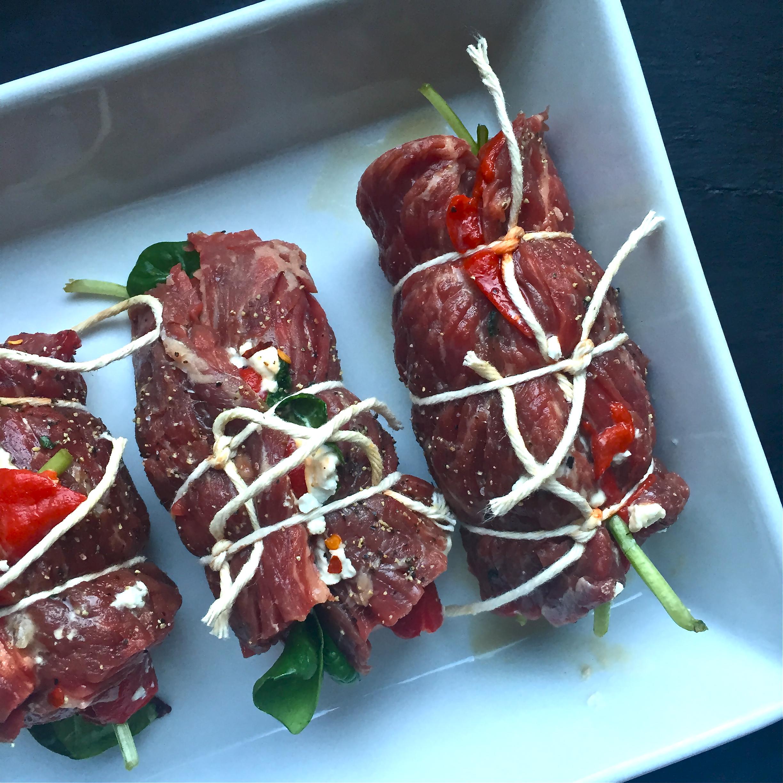 Roasted Red Pepper Goat Cheese Skirt Steak Roll Ups