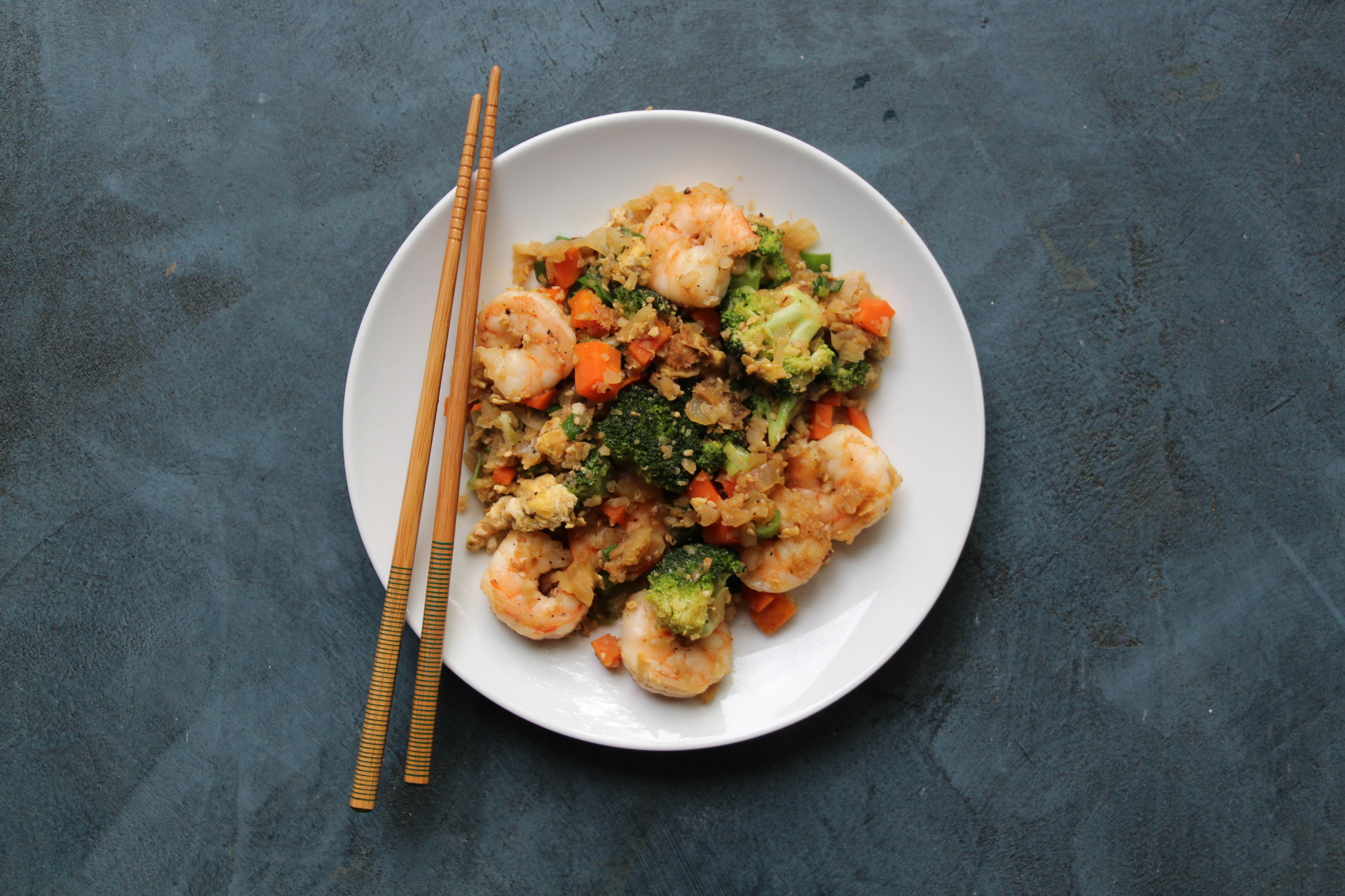 Cauliflower fried rice with shrimp the defined dish fried rice is one of those things that everyone loves its just a classic i always keep trader joes frozen cauliflower rice and frozen shrimp in my ccuart Image collections