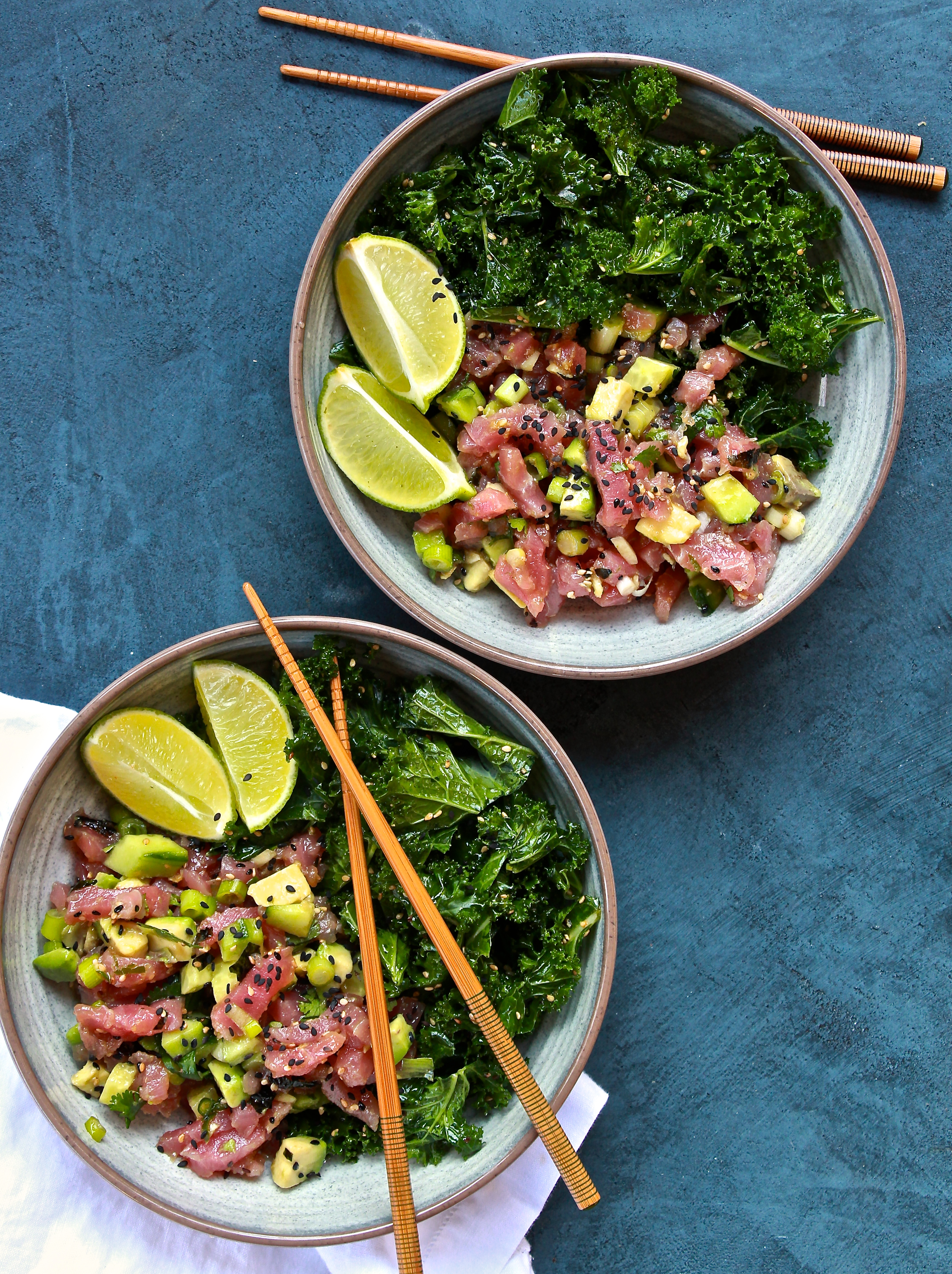 Tuna poke and sesame kale salad bowls the defined dish for Go fish poke dallas