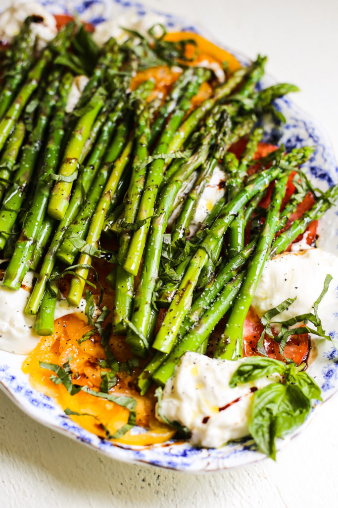 asparagus and tomato caprese salad with burrata and herbs