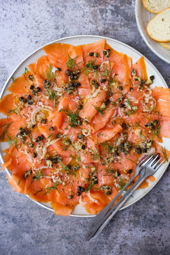 smoked salmon carpaccio with fried capers and herbs