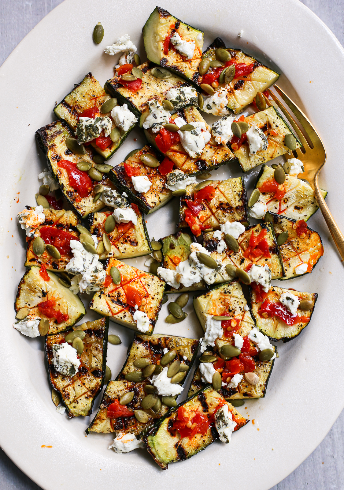 Grilled Zucchini with Calabrian Chiles, Goat Cheese, and Pepitas
